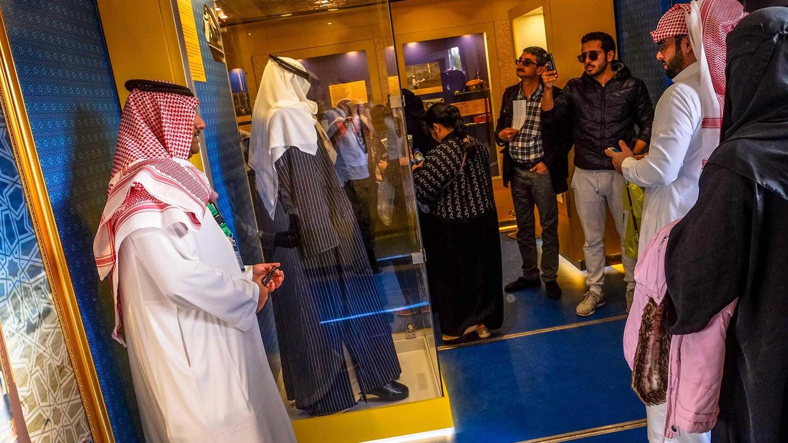 Visitors look at some of the King Abdullah artefacts.jpg